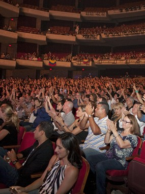 Interior view of a lively audience at the Straz Center in Tampa